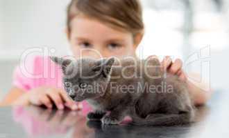 Girl with kitten at veterinary office