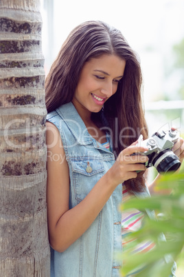 Stylish young girl looking at her camera