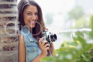 Stylish young photographer smiling at camera