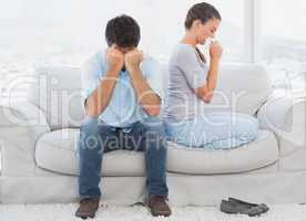 Couple on the couch after an argument