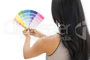 Rear view of a woman looking at paint samples