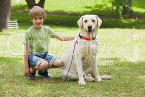 Full length of a boy with pet dog at park