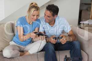 Couple playing video games in living room
