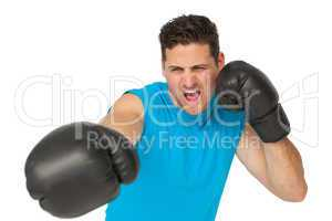 Determined male boxer focused on his training