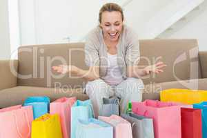 Excited woman looking at many shopping bags