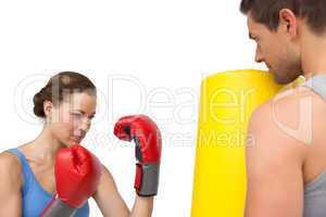 Determined female boxer focused on her training