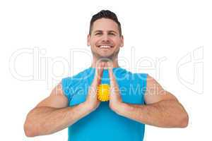 Portrait of a content young man holding stress ball