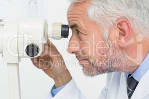Close-up side view of a senior optician