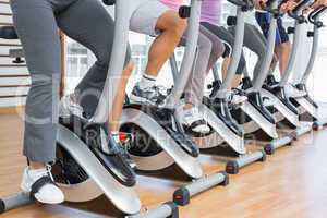 Low section of people working out at spinning class