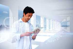 Casual man using tablet with circuit board