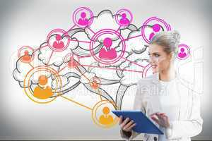 Blonde businesswoman using tablet pc with cloud computing graphi