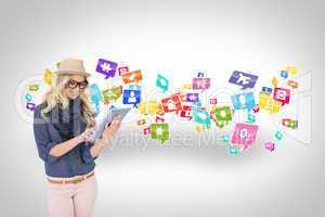 Stylish blonde using tablet pc with app icons