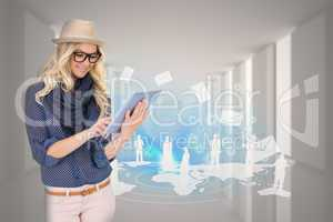 Stylish blonde using tablet pc with email and map graphic