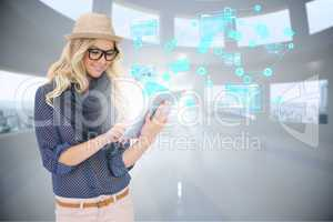 Stylish blonde using tablet pc with email and interfaces