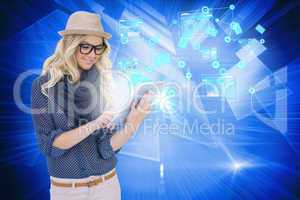 Stylish blonde using tablet pc email and interfaces
