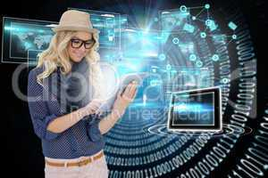 Stylish blonde using tablet pc with interfaces and email icons