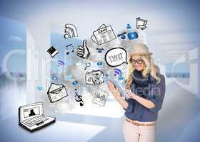 Stylish blonde using tablet pc with app icon doodles