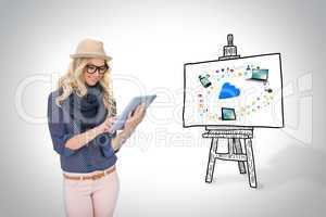 Stylish blonde using tablet pc with app icons and cloud on board