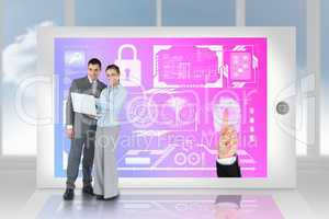 Happy business team using laptop with security interface on tabl