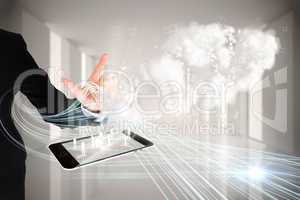 Finger pointing to clouds with tablet pc