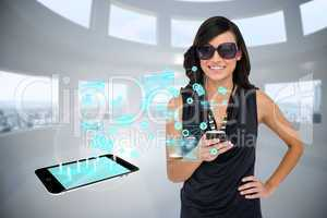 Glamorous brunette using smartphone with email symbols