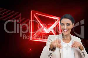 Composite image of smiling businesswoman pointing at the camera