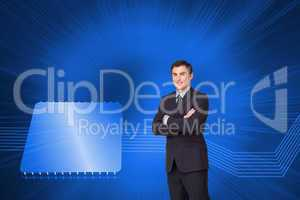Composite image of young businessman standing cross-armed