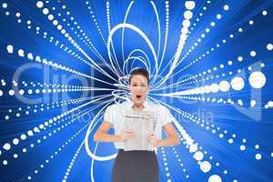 Composite image of shocked stylish businesswoman holding newspap