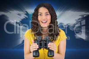 Composite image of smiling casual young woman holding binoculars