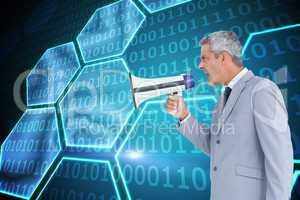 Composite image of businessman shouting in loudspeaker
