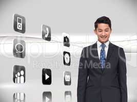 Composite image of smiling businessman looking down