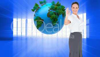 Composite image of elegant businesswoman showing an okay gesture