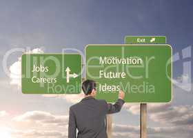 Composite image of businessman standing back to camera writing w