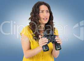 Composite image of serious casual young woman holding binoculars