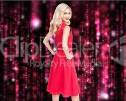 Composite image of smiling blonde standing hands on hips