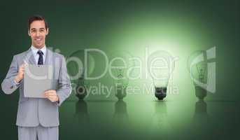Composite image of happy businessman holding a clipboard