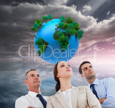 Composite image of serious work team posing together looking awa