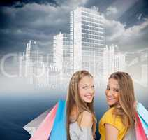 Composite image of two young women with shopping bags