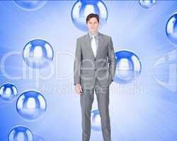 Composite image of portrait af a charismatic businessman standin