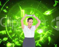 Composite image of angry businesswoman throwing her tablet pc