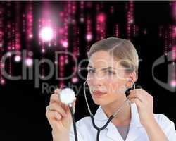 Composite image of serious nurse listening with stethoscope