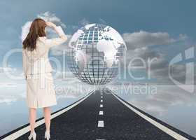 Composite image of rear view of young businesswoman looking away