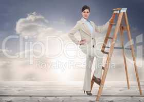 Composite image of smiling businesswoman climbing the career lad