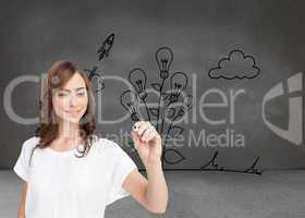 Composite image of smiling businesswoman holding marker