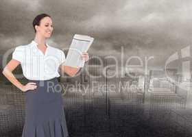 Composite image of cheerful stylish businesswoman holding newspa