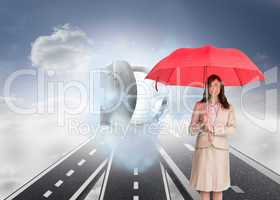 Composite image of attractive businesswoman holding red umbrella
