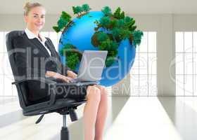 Composite image of businesswoman sitting in swivel chair with la