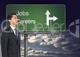 Composite image of signpost showing the direction of jobs and ca