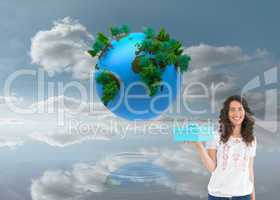 Composite image of content casual brunette holding a present