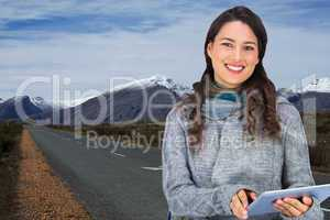 Composite image of smiling model wearing winter clothes holding